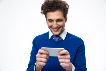 Smiling business man using smartphone over white background