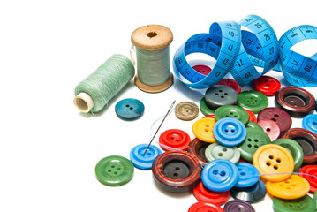 plastic buttons and spools of thread