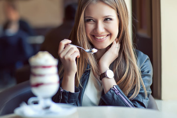 young beautiful woman in cafe