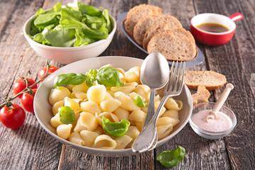 pasta, fresh salad and bread