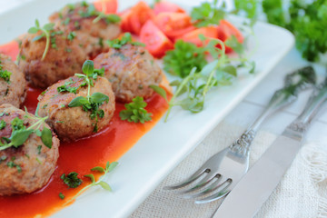 Meatballs with herbs in tomatoe sauce
