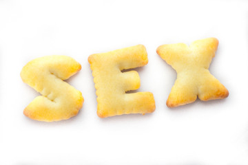 Cookies arranged in Sex Text on White Background