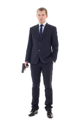 full length portrait of man in business suit with gun isolated o