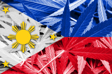 Philippines Flag on cannabis background. Drug policy.
