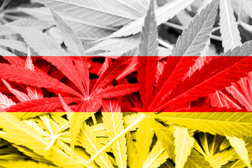 South Ossetia Flag on cannabis background. Drug policy.