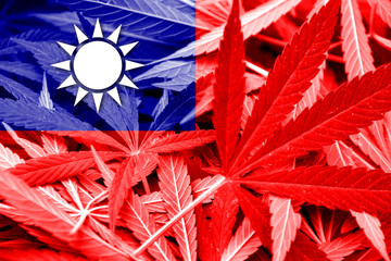 Taiwan Flag on cannabis background. Drug policy.
