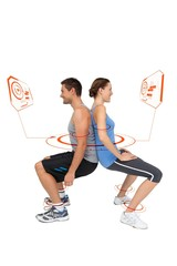 Composite image of side view of a fit young couple doing squats