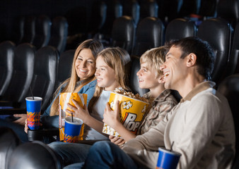 Family Enjoying Movie In Theater