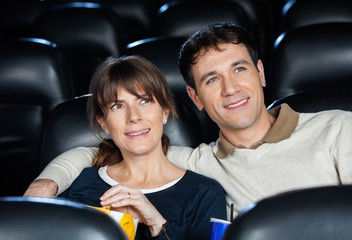 Smiling Couple Watching Movie In Theater