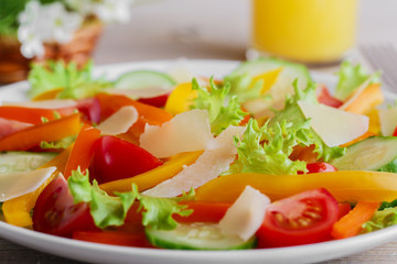 vegetable salad with tomato cucumber pepper and parmesan cheese