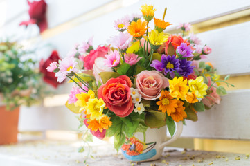 Artificial flowers in the basket in vintage theme