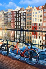 Wall Mural - Bicycles along canals with reflections, Amsterdam, Netherlands