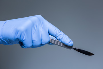 Close-up of scalpel in the hand of doctor