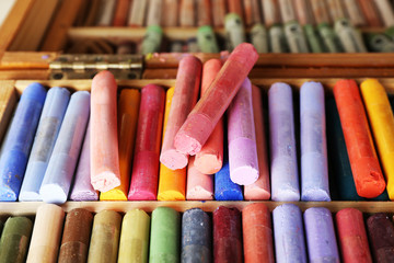 Colorful chalk pastels in box close up
