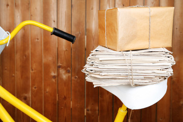 Vintage yellow bicycle with newspaper and parcel,