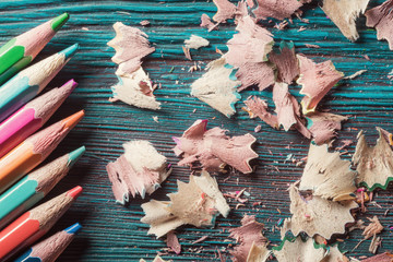 Pencils and residuals of grinding on rustic wooden background