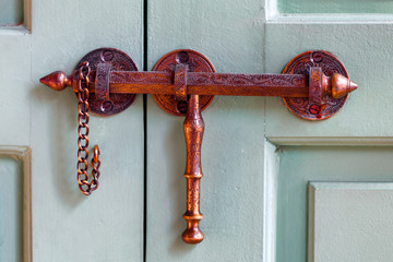 Moroccan bronze or copper door latch hardware. Close up detail