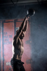 Beautiful athlete doing kettlebell swings. Profile picture. Athl