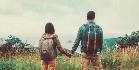 Traveler couple in love enjoying view of sea