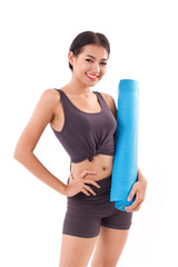 fitness woman with hand holding yoga mat
