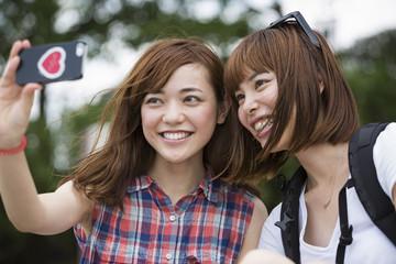 Two women taking selfie in park