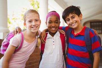 Little school kids in school corridor