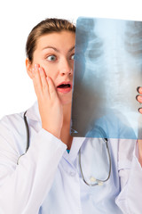 Shocked doctor with x-ray ill patient