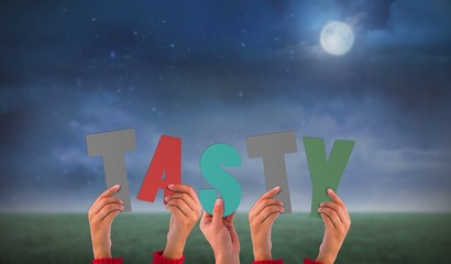 Composite image of hands holding up tasty