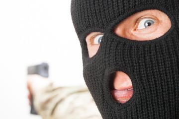 Crazy man in black mask holding gun