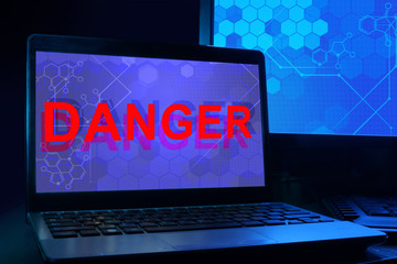 Computer with word danger.