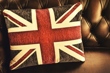 Vintage cushion with the English flag on a sofa