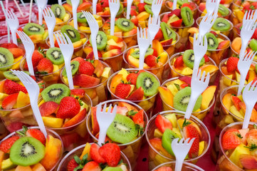 Fruit Salad arranged in plastic cups on a market stall