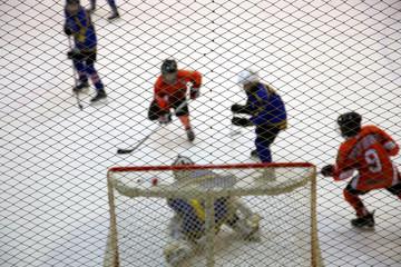 Atack of gate and ice hockey goalkeeper