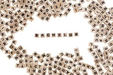 bachelor written in small wooden cubes