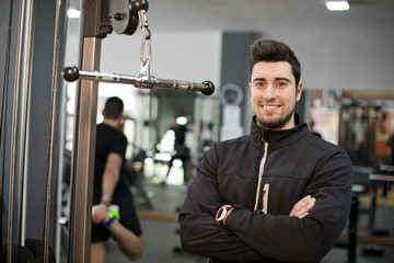 fitness personal trainer posing at gym