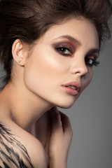 Close-up portrait of young beautiful brunette woman