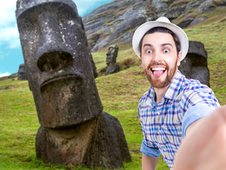 Happy young man taking a selfie photo in Easter Island, Chile