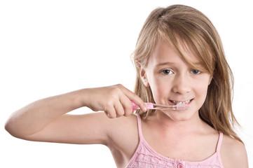 girl with toothbrush, in brushing pose
