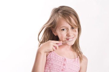 girl with toothbrush, smiling to camera