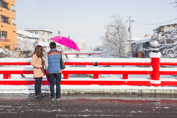 Wall Mural - romantic scene of love couples partners at red Nakabashi bridge