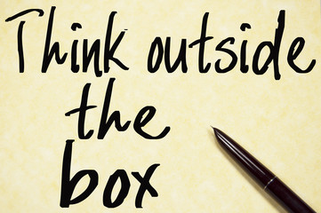 think outside the box text write on paper