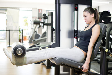 Woman at quadriceps exercise machine