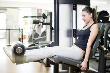 Woman at quadriceps exercise machine