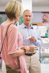 Smiling couple speaking about medication