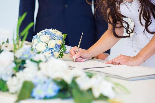 Bride signing wedding license