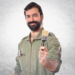 mechanic holding a brush