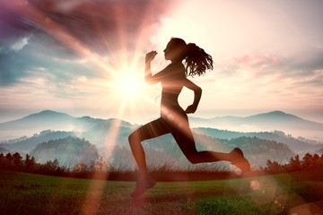 Composite image of full length of healthy woman jogging Wall mural