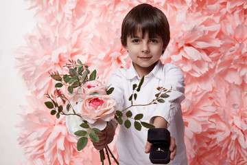 Handsome boy with flower and jewelry box ring with diamond