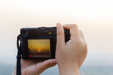 Photographers are shooting sunsets.