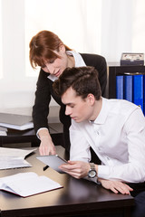 Business man and business woman teamwork in the office.